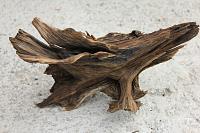 После этого необходимо слить солевой раствор и час кипятить корягу в уже пресной воде.  Затем дерево укладываем в...